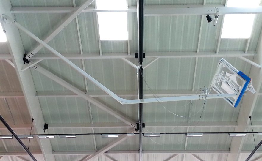 Roof mounted basketball goal raised bend with a tempered glass backboard Metalu Plast