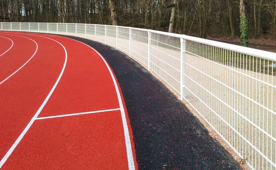 Welded mesh handrail with anti-noise system dB Lock on an athletics field